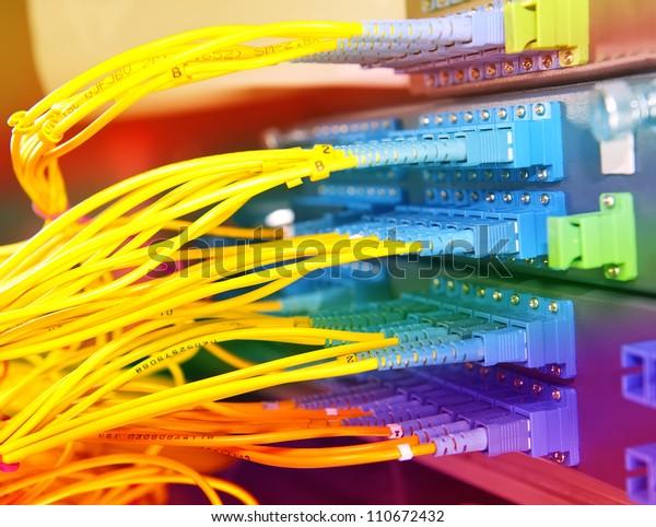 closeup of fiber optical network hub and cables