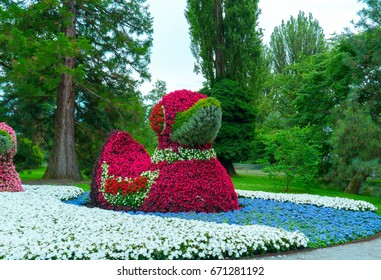 Close-up of a figure of ducks made from flowers.