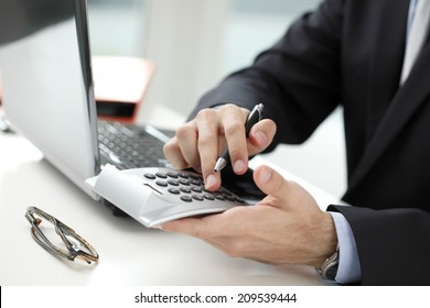 Close-up of financial advisor analyzing data in office. Business people.
