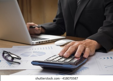 Close-up of financial advisor analyzing data in office. Business