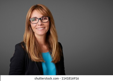 Close-up of a financial advisor businesswoman standing at isolated background.
