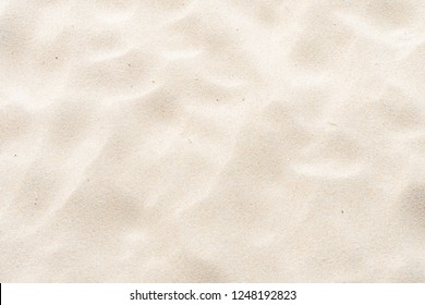 Close-up Fine beach sand in the summer sun full flame as background