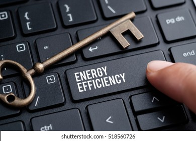 Closeup of finger on keyboard with words ENERGY EFFICIENCY