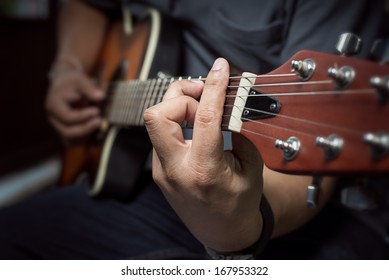 Closeup of fingers from playing acoustic guitar