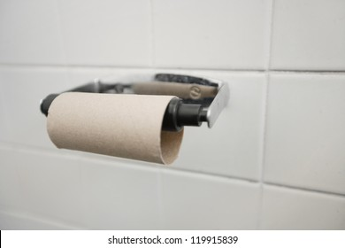 Close-up of finished toilet paper roll in bathroom