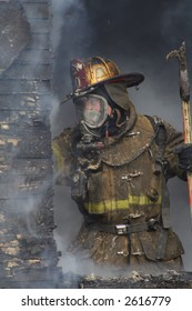 Close-up of a Fireman in a window fighting the blaze