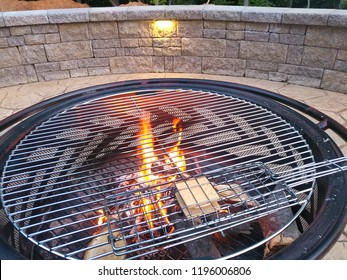 closeup of firepit heating s'more on patio