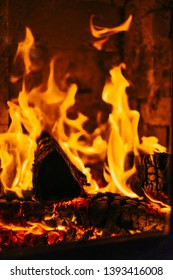 Close-up of fireplace with burning logs of wood.