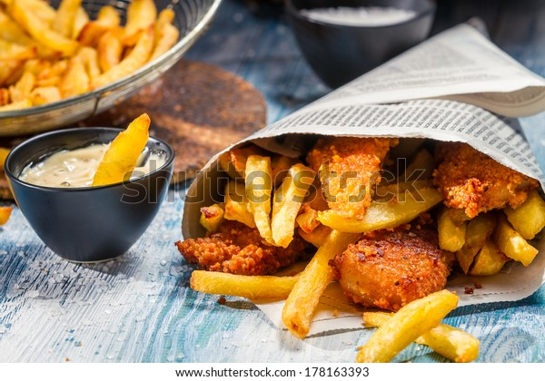 Closeup of Fish & Chips served in the newspaper