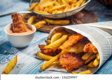 Closeup of Fish & Chips served in paper