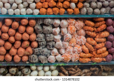Closeup of fishballs, seafoodballs, and meatballs in a pushcart's window