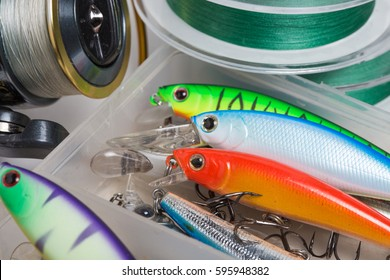 Closeup of a fishing box with colorful lures.