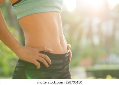 Close-up of fit female abdomen