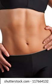 Closeup of a fit woman's abs isolated on a white background