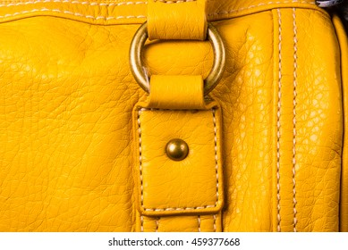 closeup of the fittings on the yellow leather hand bag
