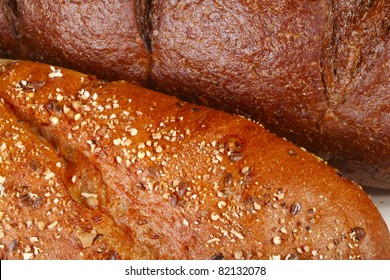A close-up of five grain and pumpernickel breads