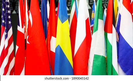 A closeup of flags of different colors standing together