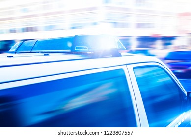 close-up of flashing blue lights on police car