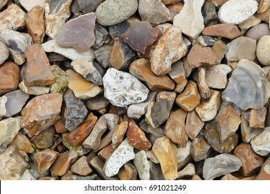 A closeup of flint stone pebbles background