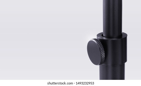 Close-up of floor lamp pole height adjustment mechanism on light grey background