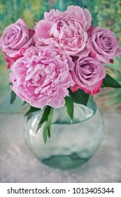 Close-up floral composition with a pink peonies and roses.