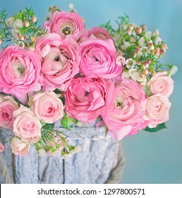 Close-up floral composition with a pink Ranunculus flowers . Beautiful bouquet of a spring flowers.