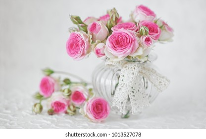 Close-up floral composition with a pink roses .Many beautiful fresh pink roses on a table.