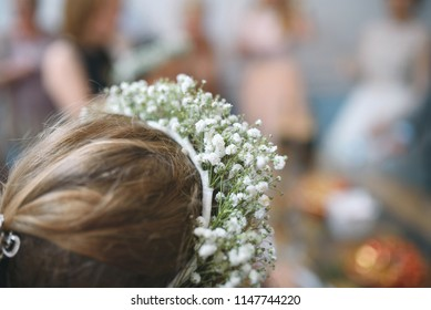 closeup of flower band on girl's head