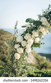 Closeup of flowers or white roses on a beautiful wedding arch. Preparation for a wedding event.