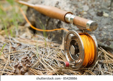 Close-up of Fly-Fishing Reel and Rod with Selective Focus