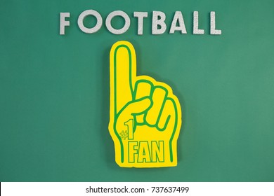 Close-up of foam hand on green background