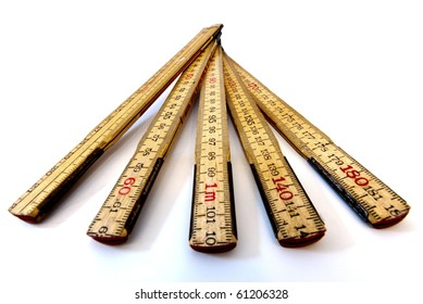 closeup of a folding wooden ruler using the metric system