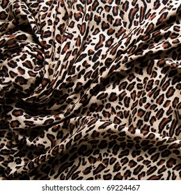 9524b5239a Close-up of a folds of stylish leopard scarf (cashmere background with a  predatory