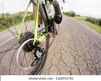 Close-up of the foot of a young man cycling. Road bike