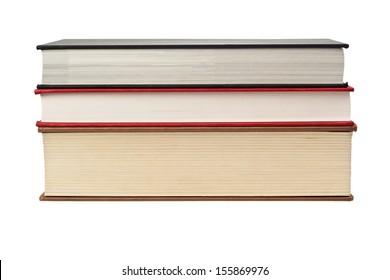 Closeup of the fore edge of three books isolated on white background