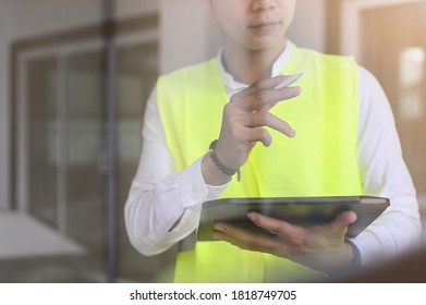 Closeup foreman officer inspector defect with tablet computer about engineer and architect work home building.