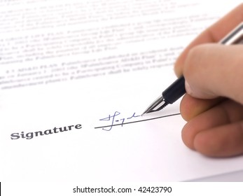 Close-up of a fountain pen and signature