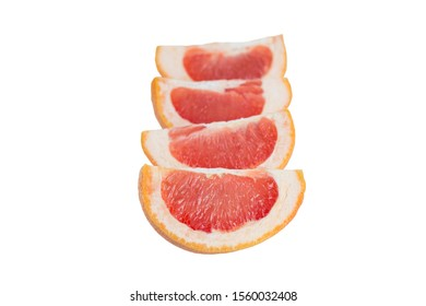 Close-up of four slices of a ripe pink grapefruit (Citrus paradisi) in line, isolated on white background.