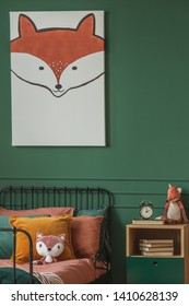 Close-up of a fox painting on a green wall above an orange and black bed for a child in a bedroom interior with plush fox toys. Real photo