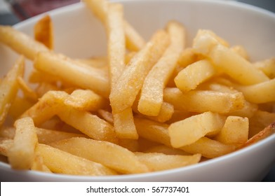 closeup of french fries  in a bowl at restaurant