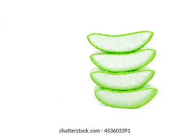Closeup fresh aloe vera slice on white background, beauty and healthy care concept, selective focus
