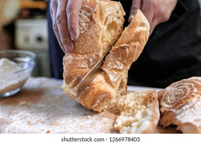 Closeup of fresh baked bread. Cook cooks bread with flour and eggs.