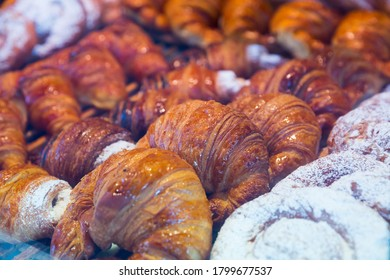 Closeup of fresh baked sweet croissants on pastry showcase in Spanish bakeshop