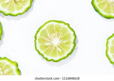 Closeup fresh bergamot fruit slice isolated on white background with clipping path