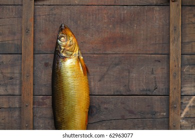 Closeup of fresh bloater lying on wooden background