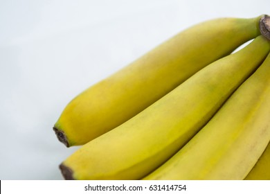 Close-up of fresh bunch of bananas on white background
