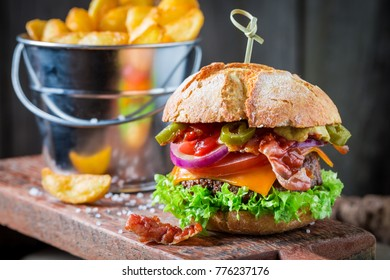 Closeup of fresh burger with onion, tomato and lettuce