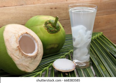 Close-up of Fresh Coconut Water Drink in glass for good  health on wooden  background.