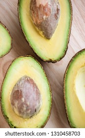 Close-up of a fresh juicy avocado on wooden table. Healthy food concept.