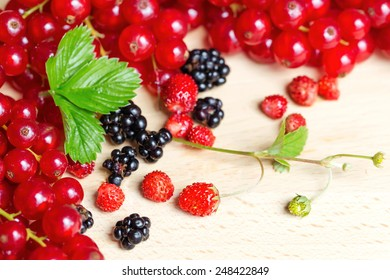 Close-up of fresh mixed berries on wood table